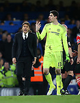 Chelsea's Antonio Conte talks to Thibaut Courtois during the Premier League match at Stamford Bridge Stadium, London. Picture date: April 25th, 2017. Pic credit should read: David Klein/Sportimage