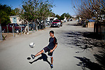 Fifteen-year-old Jesus Loera practices in the Rancho Garcia trailer park in Thermal, Calif., March 9, 2012.