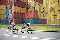 Jesper Asselman (NLD/Metec - TKH) &amp; Matthias Brandle (AUT/IAM) try to break away from the peloton with only a good 10km to go with containers from the Port of Antwerp forming an  appropriate backdrop for this race.<br /> <br /> 3rd World Ports Classic 2014<br /> stage 1: Rotterdam - Antwerpen 195km