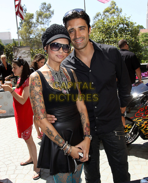 GUEST & GILLES MARINI.KISS-FM Hosts Gifting Lounge In Honor of the 11th Annual Teens Choice Awards Held at The W Hotel, Westwood, California, USA..August 7th, 2009.full length black jeans denim shirt half 3/4 tattoos necklace tank top hat sunglasses shades .CAP/ADM/KB.©Kevan Brooks/AdMedia/Capital Pictures.