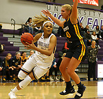SIOUX FALLS, SD - DECEMBER 7: Gloria Mulumba #21 from the University of Sioux Falls drives against Lindsay Dorr #40 from Concordia St. Paul during their game Friday night at the Stewart Center in Sioux Falls, SD. (Photo by Dave Eggen/Inertia)