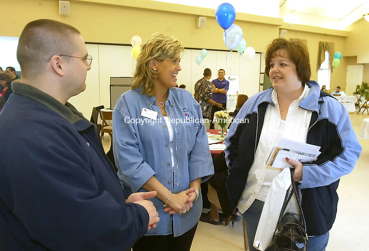 SOUTHBURY, CT 4/14/07- 041407BZ13- Jacqueline Ford, a recruiter for the Department of Children and Families, center, talks with Darryl and Mary Lanzara, of Wolcott, during the 1st annual recruitment expo sponsored by the Foster Adoptive Mission at Sacred Heart Church in Southbury Saturday.  FAM is a federally-funded colllaborative of regional organization dedicated to placing children in safe, nurturing homes in Northwest Connecticut.<br /> Jamison C. Bazinet Republican-American
