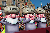 "Düsseldorf, Germany. 16 February 2015. A float carries the message that ""terror doesn't have anything to do with religion"". The traditional Shrove Monday (Rosenmontag) carnival parade takes place in Düsseldorf, Germany. 1.2 million revellers lined the route. The Monday parades went ahead despite increased terror warnings which led to the parade in Brunswick (Braunschweig) being cancelled shortly before it was due to take place."