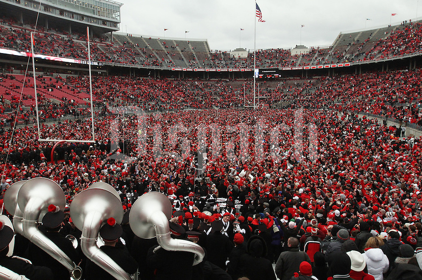 Ohio State fans pour on to the field after the Ohio State Buckeyes defeated the Michigan Wolverines 26 - 21 in their NCAA football game at the Ohio Stadium, November 24, 2012.   (Dispatch photo by Neal C. Lauron)