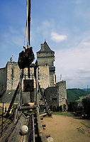 Castelnaud, Sarlat, France. ancient architecture, tower, catapult in the foreground, military weapons, machinery. Sarlat France.