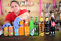 Antojitos Los Amigos de Norma serves Honduran food at the Westbank Nawlins Flea Market. Normas Rojas sets out her many imported drinks from Latin America.