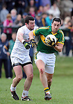 25-02-12: Anthony Maher, Kerry, breaks away from Padraig O'Neill, Kildare, during the senior football challenge match between Kerry and Kildare at the Ballymacelligott GAA Club official pitch reopening on Saturday.  Picture: Eamonn Keogh (MacMonagle, Killarney)