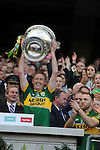 Colm Cooper lifts the Sam Maguire Cup to celebrate  Kerry's victory over Donegal in the All-Ireland Football Final against  in Croke Park 2014.<br /> Photo: Don MacMonagle<br /> <br /> <br /> Photo: Don MacMonagle <br /> e: info@macmonagle.com