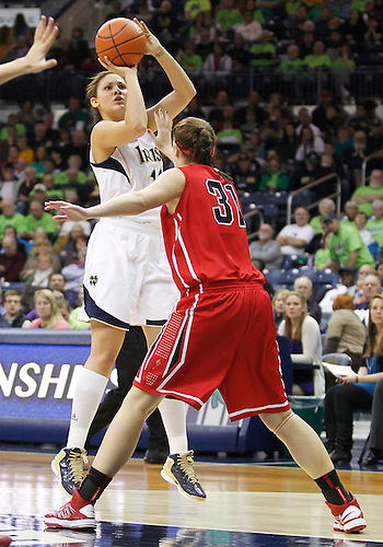 December 31, 2012:  Notre Dame forward Natalie Achonwa (11) goes up for a shot as St. Francis guard Rebecca Keegan (31) defends during NCAA Women's Basketball game action between the Notre Dame Fighting Irish and the St. Francis (PA) Red Flash at Purcell Pavilion at the Joyce Center in South Bend, Indiana.  Notre Dame defeated St. Francis 128-55.