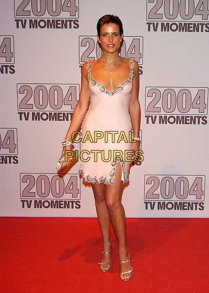 """SOPHIE ANDERTON.""""2004 TV Moments Awards Ceremony"""" .at BBC Television Centre.London 22 January 2005.full length pale pink peach dress gold purse clutch bag.www.capitalpictures.com.sales@capitalpictures.com.©Capital Pictures"""