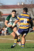 Joshua Tafili makes a run at Palu Ale. Counties Manukau Premier Club Rugby game between Manurewa and Patumahoe, played at Mountfort Park Manurewa on Saturday June 23rd 2018. Patumahoe won the game 29 - 24 after trailing 12 - 19 at halftime.<br /> Manurewa Kidd Contracting 24 - Petelo Ikenasio, David Osofua, Paolelei Luteru, Pisi Leilua tries, Timothy Taefu 2 conversions,<br /> Patumahoe Troydon Patumahoe Hotel 29 - Kalim North, Shea Furniss, Jonny Wilkinson, Mark Royal, James Brady tries,  Broc Hooper 2 conversions.<br /> Photo by Richard Spranger