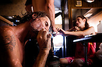 "Niland, California, July, 12, 2008 -  Jerry Jones takes a hit from his pipe, while friend Ben Morofsky teases his wife Moriah by hiding her pipe in his pants. Jerry says that he uses the drugs to escape the pain of his wife dying. Adding, ""It hurts, man. I mean, sitting here watching your wife dying and not being able to do nothing. It just kills me."""