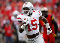 Ohio State Buckeyes running back Ezekiel Elliott (15) rushes upfield during the third quarter of the NCAA football game against the Maryland Terrapins at Byrd Stadium in College Park, Maryland on Oct. 4, 2014. (Adam Cairns / The Columbus Dispatch)