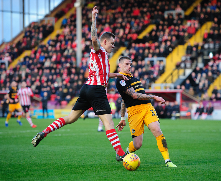 Lincoln City's Harry Anderson vies for possession with Newport County's Scot Bennett<br /> <br /> Photographer Chris Vaughan/CameraSport<br /> <br /> The EFL Sky Bet League Two - Lincoln City v Newport County - Saturday 22nd December 201 - Sincil Bank - Lincoln<br /> <br /> World Copyright © 2018 CameraSport. All rights reserved. 43 Linden Ave. Countesthorpe. Leicester. England. LE8 5PG - Tel: +44 (0) 116 277 4147 - admin@camerasport.com - www.camerasport.com