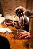 USA, California, Sonoma, pouring wine at the tasting room bar, Bartholomew Park winery and vineyard