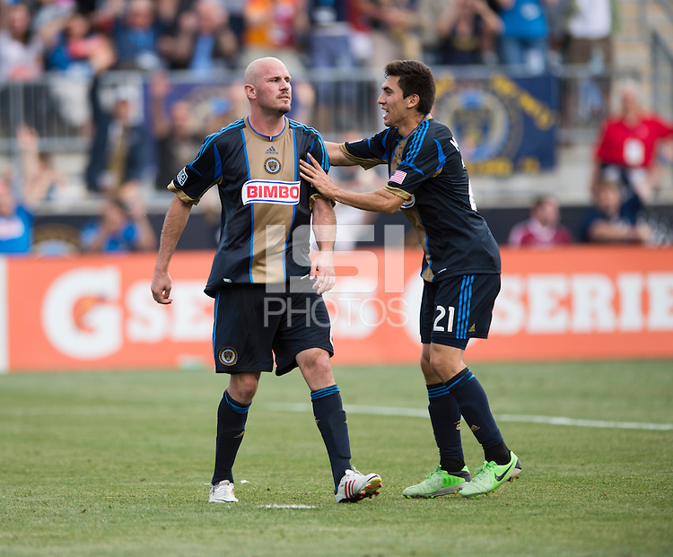 Conor Casey (6) of the Philadelphia Union celebrates his goal with teammate Michael Farfan (21) of the New York Red Bulls during a Major League Soccer game at PPL Park in Chester, PA.  Philadelphia defeated New York, 3-0.