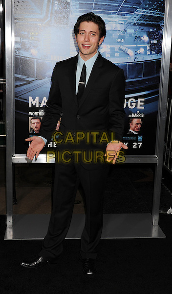 Jackson Rathbone.L.A. Premiere of 'Man on a Ledge' held at The Grauman's Chinese Theatre in Hollywood, California, USA..January 23rd, 2012.full length suit black blue tie hands.CAP/ROT/TM.©Tony Michaels/Roth Stock/Capital Pictures