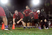 """9 February 2007: Gustav Rydstedt runs a drill with Andy Buh during a """"Friday Night Lights"""" practice at Stanford Stadium in Stanford, CA."""