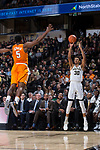 Olivier Sarr (30) of the Wake Forest Demon Deacons fires up a three-point shot over Admiral Schofield (5) of the Tennessee Volunteers during first half action at the LJVM Coliseum on December 23, 2017 in Winston-Salem, North Carolina.  The Volunteers defeated the Demon Deacons 79-60.  (Brian Westerholt/Sports On Film)
