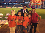 """MCLIMS students at """"Celebrating Diversity & World Peace"""" at Minute Maid Park (from left): Judah Thibaut, Azul Leon, McKinley Haley, Santiago Martinez, Victoria Long, and Faris Vehra with Principal ChaoLin Chang."""