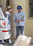 8-8-09  Exclusive...Oscar Winner Sean Penn tipping the Valet $4 while wearing a blue Yamaha hat. Sean was leaving the Malibu Inn Hotel after taking his mother Eileen Ryan & son Hopper out to lunch. Sean was reading a book called CHEATING at BLACKJACK by Dustin D Mark.  Times must be tough for Sean he needs to cheat at black jack to make some extra cast. ....AbilityFilms@yahoo.com.805-427-3519.www.AbilityFilms.com