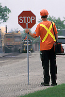 Flagman on Road Resurfacing Project - Facing Away