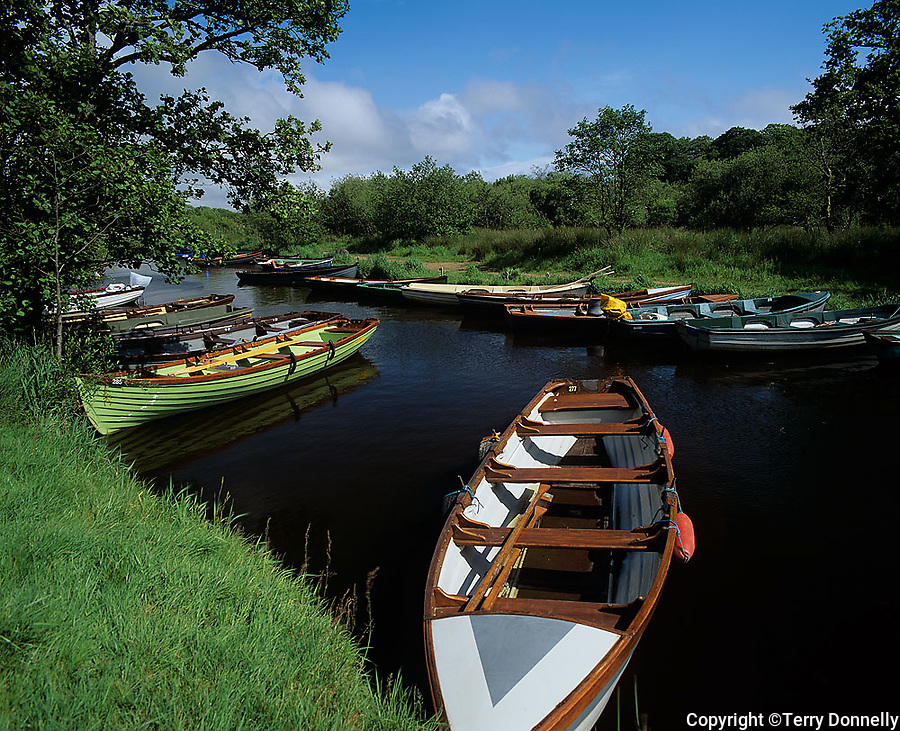 County Kerry, Ireland          <br /> Wooden fishing boats moored on the waterway near Ross Bay of Lough Leane, Kilarney National Park, on the Ring of Kerry