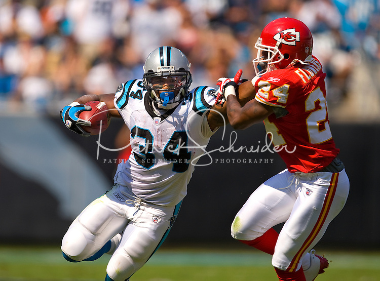 Carolina Panthers running back DeAngelo Williams (34) runs against Kansas City Chiefs cornerback Brandon Flowers (24) during a NFL football game at Bank of America Stadium in Charlotte, NC.