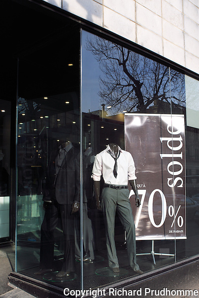 Men's clothing store in downtown Montreal having a 70% off sale