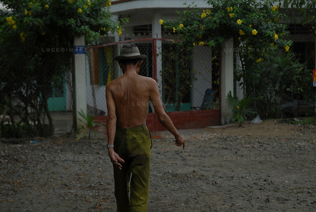 A Vietnamese man walks back to this house outside of Ho Chi Minh City, Vietnam.