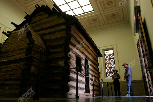 The birthplace of Abraham Lincoln, now a Historic site kept up by the National Park Service.  A period cabin, similar to the one Lincoln lived in, stands inside a white marble memorial.  Lincoln lived here till he was about 2 1/2 years old. Hodgenville, Kentucky, May 26, 2005