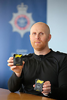 Inspector Rob Miles who is in charge of the body cameras. Wednesday 17 May 2017<br /> Re: Body worn video cameras are being introduced into the South Wales Police force as part of operational equipment and will be rolled out over the next few months.<br />  Forces across the UK are using this technology and integrating it into daily policing activities.  Body worn video may be used in court as evidence and for investigative purposes, including complaints against police or as a training material for police. <br />  Other forces have seen a range of benefits from using body worn video to support their general patrolling and investigative tasks. These benefits include:<br /> Gathering and presentation of evidence<br /> Changing the behaviour of offenders<br /> Lower incidence or escalation of violence<br /> Increased guilty pleas by defendants<br /> Increased time on patrol and less time spent on paperwork<br /> Improved public co-operation and interactions with police<br /> Improved transparency and accountability<br /> Professionalising police interaction<br /> Assistant Chief Constable Richard Lewis said: &ldquo;Equipping our officers with body worn cameras is the start of a new way we capture, utilise and share digital evidence.  The technology is very exciting and will assist officers and staff in doing their jobs, it will ensure that we are more accountable to the public that we serve and in turn build trust with our communities.