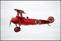 BNPS.co.uk (01202 558833)<br /> Pic: RobHenry/BNPS<br /> <br /> The feared Fokker Dreidecker of the Red Baron has finally flown over Britian skies - after British based German doctor 'Baron' Peter von Brueggemann spent 9 years building a replica in his garage.<br /> <br /> The German GP based in Norfolk has spent 9 years building a Fokker triplane as a tribute to infamous WW1 Ace Manfred von Ricthofen, who terrorised the skies over the Western front during the first war.<br /> <br /> Dr Peter Brueggemann, 53, fufilled his childhood dream and emulated the notorious German fighter Ace when his hand built Dreidecker finally took off this week.<br /> <br /> Dr Brueggemann has even acquired the title Baron from the independent territory of Sealand so he can take to the skies as Baron Peter von Brueggemann in homage to his idol.<br /> <br /> The GP at the Holt Medical Practice in Norfolk finally reached for the sky at Felthorpe airfield near Norwich this week in front of nervous friends and family after thousands of hours spent crafting the aircraft.<br /> <br /> The father-of-two, who has lived in England with wife Sue for 20 years, has been taking flying lessons since his project began.