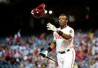 Apr. 26, 2011; Phoenix, AZ, USA; Arizona Diamondbacks outfielder Justin Upton tosses his helmet after popping out in the first inning against the Philadelphia Phillies at Chase Field. Mandatory Credit: Mark J. Rebilas-