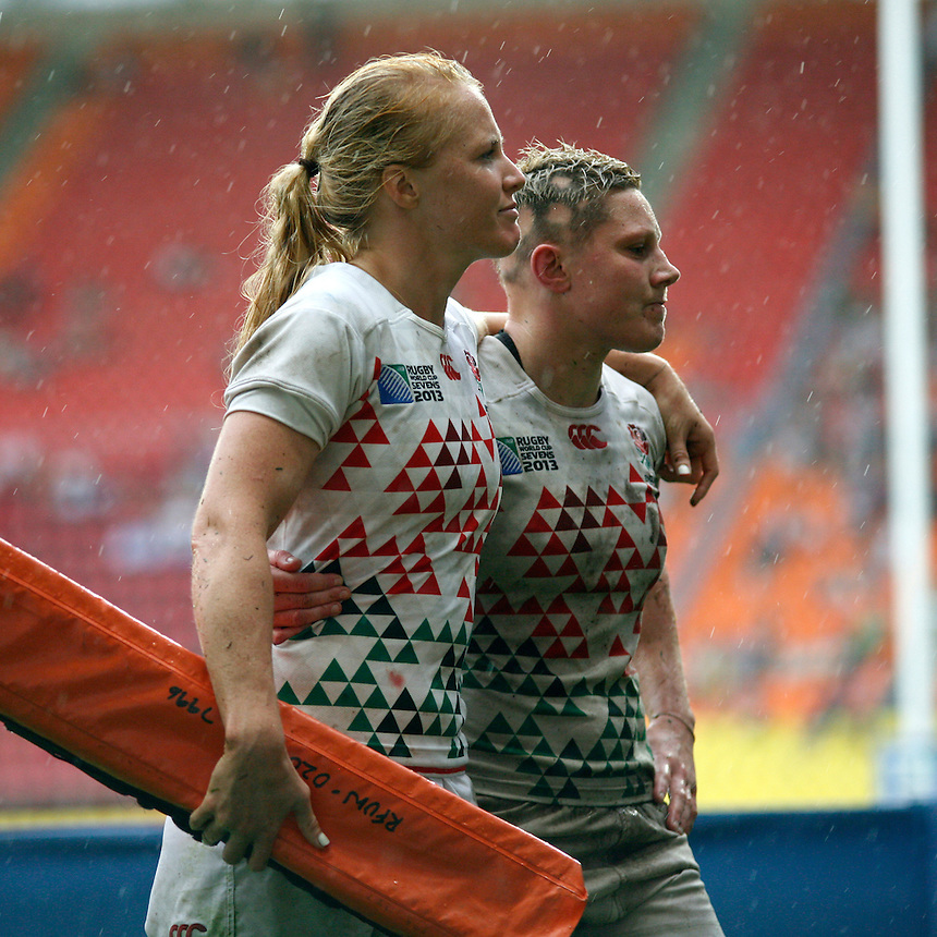 Michaela Staniford and Heather Fisher leave the pitch after losing the Plate Final. IRB RWC 7s at Luzhniki Stadium, Moscow, 30th June 2013