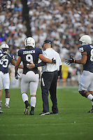 15 September 2012:  Penn State coach Bill O'Brien gives FB Michael Zordich (9) a pat on the back after the offense scored a TD.  The Penn State Nittany Lions defeated the Navy Midshipmen 34-7 at Beaver Stadium in State College, PA..