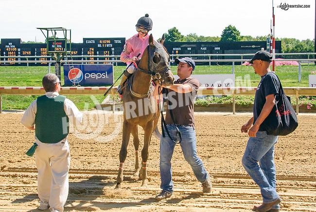 Sean Jones unsaddling Cadillac Rose at Delaware Park on 9/23/15