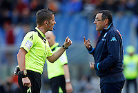 Calcio, Serie A: Roma vs Napoli. Roma, stadio Olimpico, 25 aprile 2016.<br /> Napoli&rsquo;s coach Maurizio Sarri, right, argues with referee Daniele Orsato during the Italian Serie A football match between Roma and Napoli at Rome's Olympic stadium, 25 April 2016.<br /> UPDATE IMAGES PRESS/Riccardo De Luca