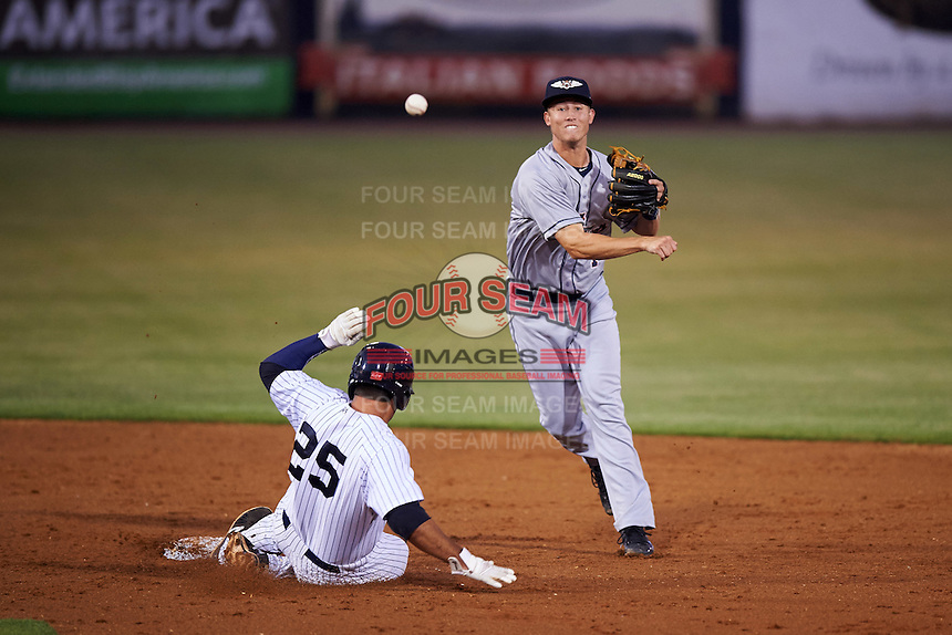 Lakeland Flying Tigers shortstop A.J. Simcox (1) throws to first as Mike Ford (25) slides into second during a game against the Tampa Yankees on April 8, 2016 at George M. Steinbrenner Field in Tampa, Florida.  Tampa defeated Lakeland 7-1.  (Mike Janes/Four Seam Images)