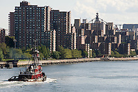Moran Towing Corp.'s tugboat Jennifer Turecamo cruises down the East River past Randall's Island in New York City.
