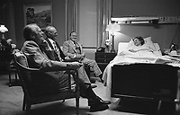 President Ford, Bob Hope, and Hugh Davis visit Mrs. Ford at the Bethesda Naval Hospital, Bethesda, MD, during her recovery from breast cancer surgery. October 5, 1974.