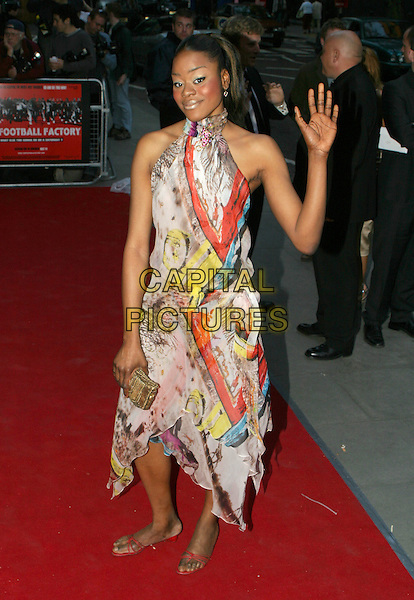 DARLENE CAKE.The Football Factory - UK Charity Film Premiere, Odeon, West End, London, WC2.May 10th, 2004.halterneck dress, waving, gesture, full length, full-length.www.capitalpictures.com.sales@capitalpictures.com.© Capital Pictures..