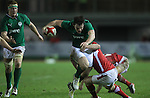 Ireland centre Tom Daly powers his way through the tackle of Steffan Hughes..Under 20 Six Nations.Wales v Ireland.Eirias - Colwyn Bay.01.02.13.©Steve Pope