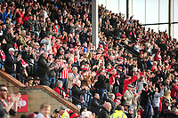 Lincoln City fans celebrates scoring his side's equalising goal to make the score 1-1<br /> <br /> Photographer Andrew Vaughan/CameraSport<br /> <br /> The EFL Sky Bet League Two - Lincoln City v Macclesfield Town - Saturday 30th March 2019 - Sincil Bank - Lincoln<br /> <br /> World Copyright © 2019 CameraSport. All rights reserved. 43 Linden Ave. Countesthorpe. Leicester. England. LE8 5PG - Tel: +44 (0) 116 277 4147 - admin@camerasport.com - www.camerasport.com