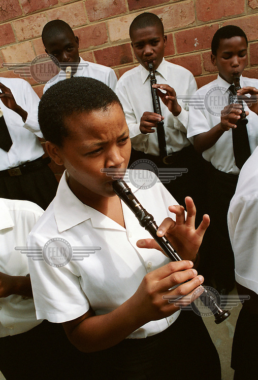 Pupils play recorders during a music lesson at Zwelibanzi High School in Umlazi Township.