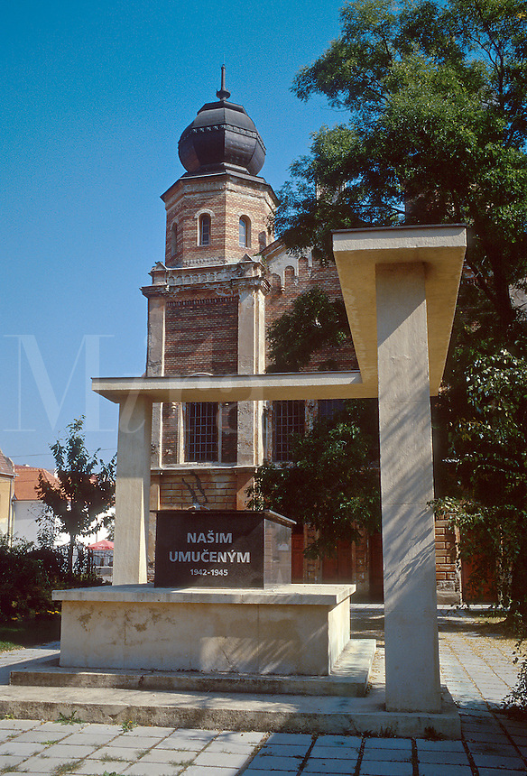 """Memorial to Jewish Holocaust victims outside synagogue that has been converted to a museum. The inscription on the tomb translates as """"Our Victims"""". 1031627. Trnava, Slovakia."""