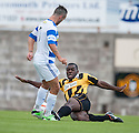 East Fife's Joe Mbu clears from Morton's Dougie Imrie.