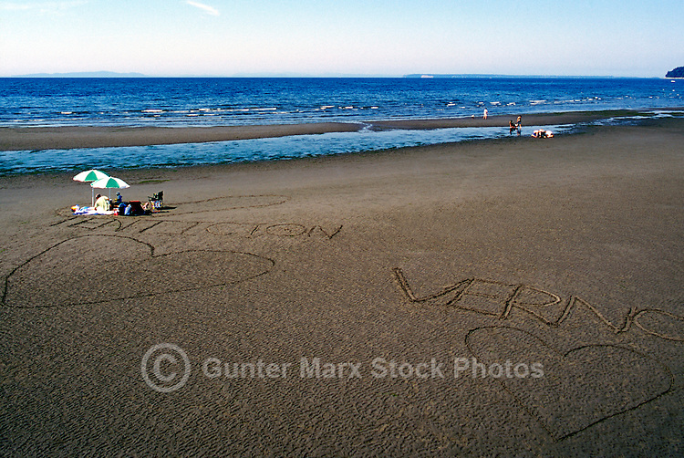 Summer Recreational Activities at White Rock, BC, British Columbia, Canada - People sunbathing on Sandy Beach along Semiahmoo Bay, Romantic Hearts drawn in Sand
