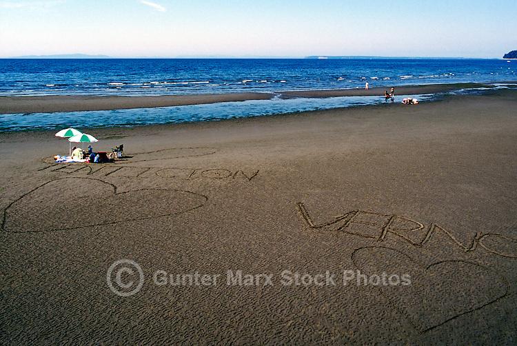Summer Recreational Activities at White Rock, BC, British Columbia, Canada - People sunbathing on Sandy Beach along Semiahmoo Bay, Romantic Hearts drawn in Sand