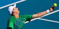 GREG JONES (AUS) against ALEXANDR DOLGOPOLOV (UKR) in the first round of the men's singles. Alexandr Dolgopolov beat Greg Jones 1-6 4-6 6-1 6-1 6-2..16/01/2012, 16th January 2012, 16.01.2012..The Australian Open, Melbourne Park, Melbourne,Victoria, Australia.@AMN IMAGES, Frey, Advantage Media Network, 30, Cleveland Street, London, W1T 4JD .Tel - +44 208 947 0100..email - mfrey@advantagemedianet.com..www.amnimages.photoshelter.com.